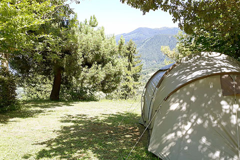 pitch tent campsite isere french alps view mountain valley